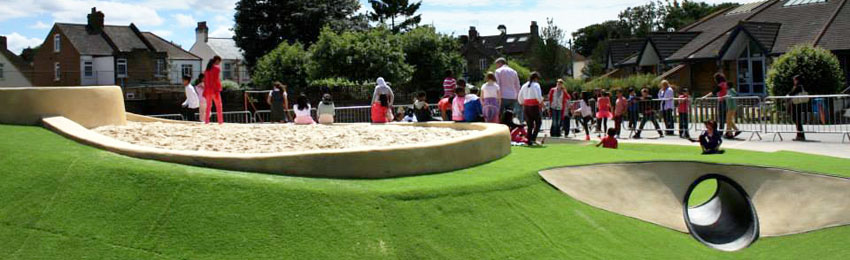 Our sandpit and jumping tower, surrounded by a dry  moat with crawling tunnels at Grove Road Primary School Hounslow